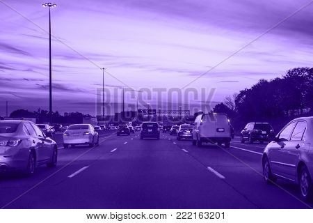 Night ultra violet traffic, cars on highway road on evening night in busy city, urban view