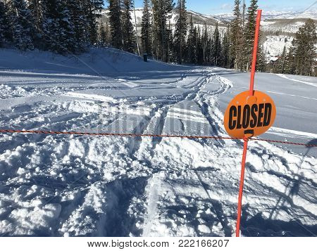 A Deer Valley run is closed but some skiers went on it anyway as they could not resist skiing fresh powder.