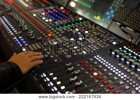 Close up view of digital audio production console. Selective focus.