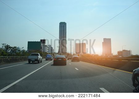 Car driving on high way road at sunset,Cars on the stretched road and The road leading to the eye,Car on road