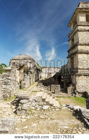 PALENQUE, MEXICO - NOVEMBER 29: An unknown person explores The Palace, one of the Mayan buiding ruins on November 29, 2016 in Palenque. Palenque was declared a world heritage site by UNESCO in 1987.