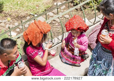 San Juan Ostuncalco, Guatemala - June 24: An Unidentified Young Girl In Traditional Dress With Other