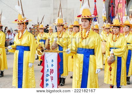 Performers Wearing Korean Traditional Dress And Holding Flags