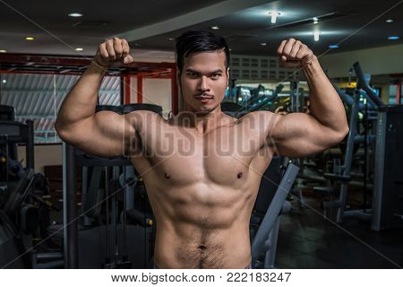 Personal Fitness Trainer Show His Muscles Or Strong Bald Bodybuilder With Six Pack
