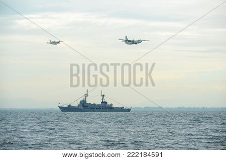 Pattaya, Thailand - November 20, 2017: Navy warships running on sea while warplanes flying above warships on the 50th anniversary ASEAN international fleet review 2017 in Pattaya, Thailand