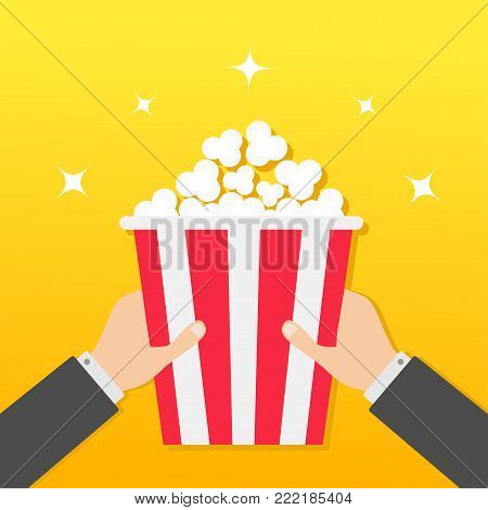 Two human businessman hands holding popcorn box. Movie Cinema icon in flat design style. Pop corn. Yellow gradient background. Shining stars. Vector illustration