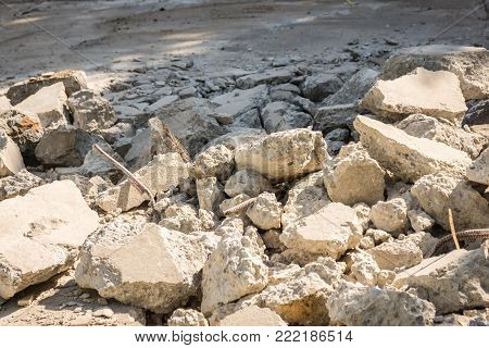 Destruction of old concrete,Crushed concrete slabs and steel bars, Before placing new concrete.