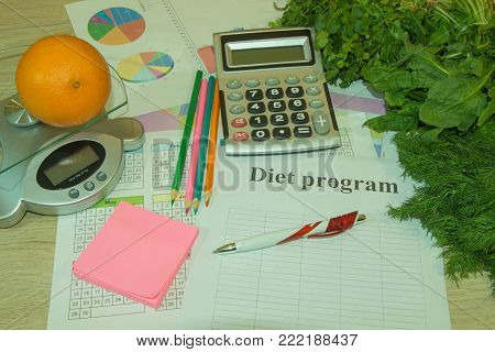Diet plan. The concept of weight loss, wellness and healthy lifestyle. Vegetarian fruit diet. Products with low fat content. Fruits and measuring tape. Fruits and vitamins with measuring tape