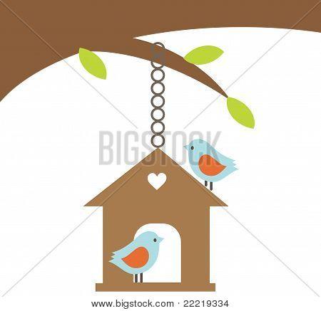 Bird couple with a house