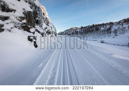 Newly groomed ski track in the winter landscape in Brokke, Norway