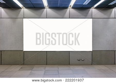 Blank billboard and horizontal big poster in metro subway station. Useful for your advertising.