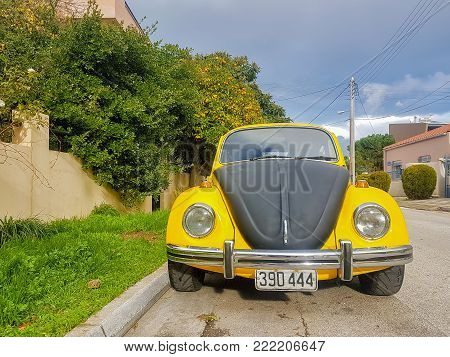 Athens, Greece 28 December 2017. Old retro sport yellow-black beatle car parked on the road.