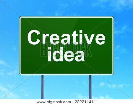 Business concept: Creative Idea on green road highway sign, clear blue sky background, 3D rendering