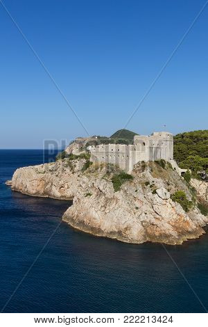 View of Fort Lovrijenac (St. Lawrence Fortress) on a steep cliff in Dubrovnik, Croatia on a sunny day. Copy space.