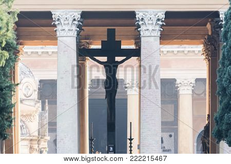 BOLOGNA,ITALY-DECEMBER 12,2016:Old crucified inside the monumental cemetery of the Certosa di Bologna during a sunny day.