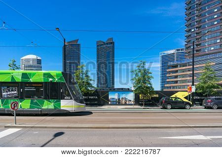 Melbourne, Australia - December 7, 2016: Tramway approaching a station in Docklands, Melbourne
