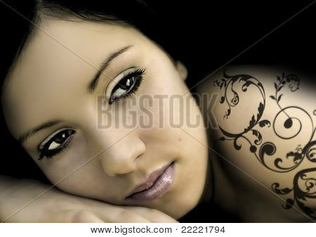 alluring woman with black ornament-tattoo