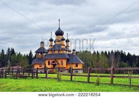 Wooden church of the Prophet John the Baptist shown after rain, Dudutki, Belarus
