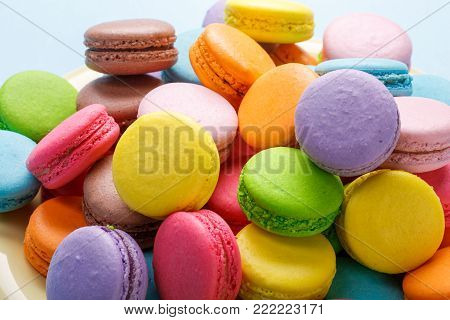 Colorful French macaroons. Coffee, chocolate, vanilla and raspberry macaroons