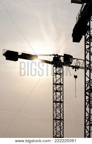 Abstract image of the construction crane at the back light