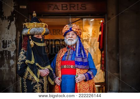 VENICE, ITALY -  FEBRUARY 27, 2014: Carnival of Venice. Man and woman in image of Eastern rulers at festival of carnival costumes in Venice.