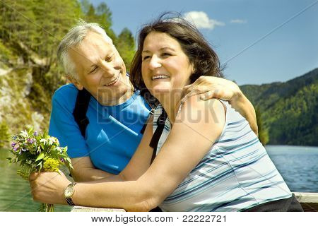 lovely mature couple beside a lake