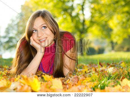 a cute girl in autumn