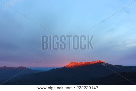 Crimean landscape in morning. Chatyr-Dag mountain in the first rays of the rising sun. This mountain is a symbolic significance for the history of the Crimean peninsula.