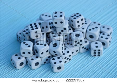 a pile of small game blocks on a blue table