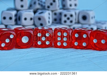 a row of red dice on a blue background