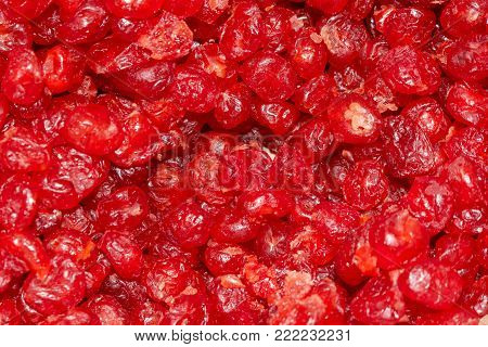 dried cranberrie fruit on a pile on a food market, coloful dried fruits, dried fruits