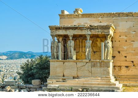Ancient Greek Temple of the Erechtheum on Acropolis at sunset.