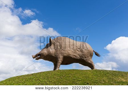 Champagne-Ardenne , France - Septemebr 9, 2017: Symbol of Champagne Ardenne region the largest wild boar in the World on a grass hill.