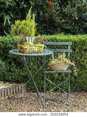 Giethoorn, The Netherlands - November 31, 2016:  Garden table and chair with baskets in the small picturesque village of Giethoorn in Overijssel, Netherlands.