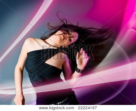 young teenage-girl dancing in laserbeam-discolight