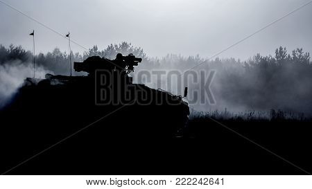 INFANTRY FIGHTING VEHICLE - A military vehicle in the sun and in the dust