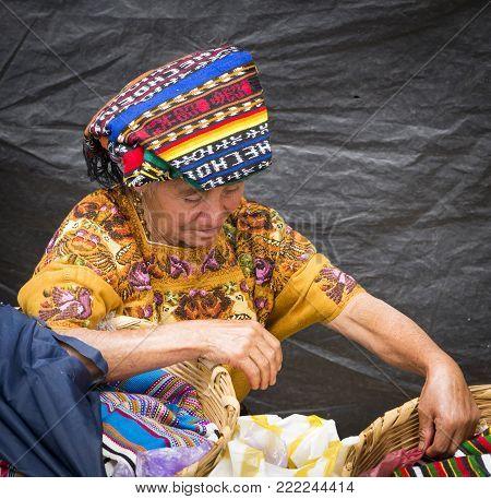 San Juan Ostuncalco, Guatemala - June 24: Unidentified Mayan Woman In Traditional Dress Selling Good