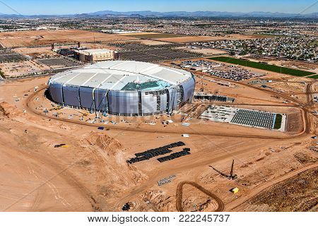 Archival aerial photo of football stadium and hockey arena construction in Glendale, Arizona back in 2005