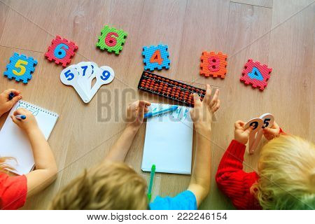 little boy and girls learning numbers, mental arithmetic, abacus calculation