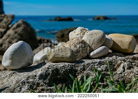 A few rock's on a bigger rock on the beach