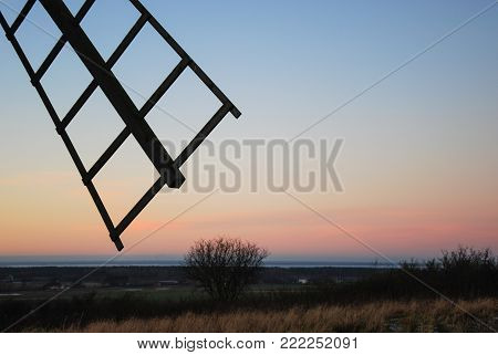 Wooden windmill detail by a landscape at the swedish island Oland