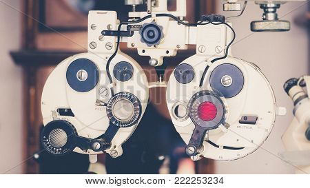 Close Up Of Old Vintage Eyesight Measurement Or Ophthalmologists With Optical Phoropter. Eye Sight V