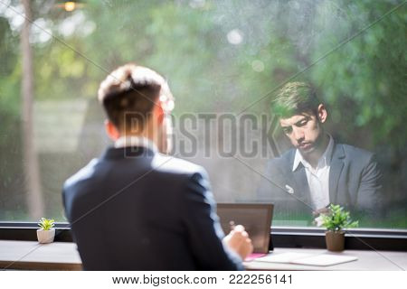 Inselective Focus of Blurred Business Background.Confident Business People using tablet While Writing On Notebook in Coffee Shop. Outdoor Portrait, Internet, Text and Touch Screen.Lonely Man Moment.