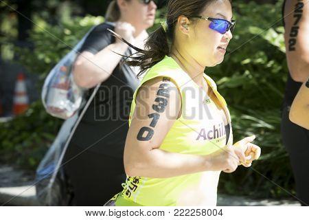 NEW YORK - JULY 16 2017: Achilles International athlete runs through Riverside Park in the 10k portion of the Panasonic New York City Triathlon Race, the only International Distance triathlon in NYC.