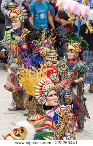 SAN JUAN OSTUNCALCO, GUATEMALA - JUNE 24: Traditional dance done by locals with elaborate costumes and masks at the San Juan Ostuncalco fair in honor of Saint John the Baptist on June 24, 2017 in Guatemala.