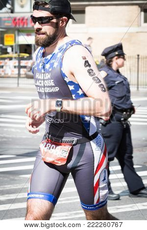 NEW YORK - JUL 16 2017: Athlete runs on West 72nd St during the 10k portion of the Panasonic New York City Triathlon Race, the only International Distance triathlon in NYC.