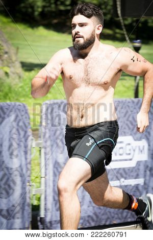 NEW YORK - JUL 16 2017: Athlete approaches the finish line in Central Park of the Panasonic New York City Triathlon Race, the only International Distance triathlon in NYC.