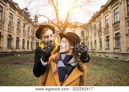 cheerful attractive young couple infront of building