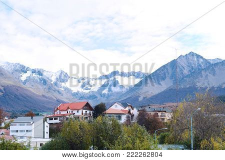 View of houses with snowy mountains at the back in Ushuaia, Patagonia, Argentina.