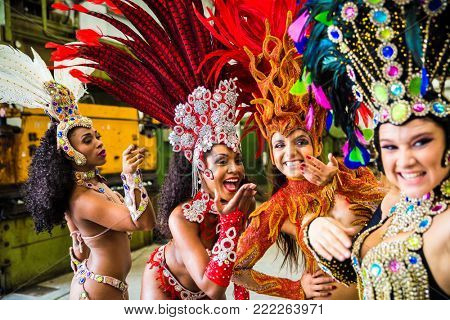 Brazilian women wearing carnival costume in an old factory